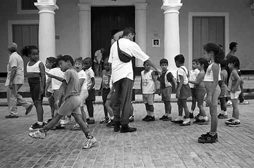 Cuban elementary students line up in martial form after a field trip through the city. In Cuba, the land of party-run TV, nobody stays in to watch television. © Kevin Moloney, 2001.