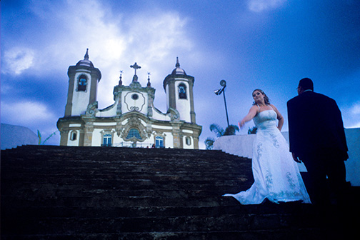 A bride poses for pre-nuptial photos near the Church of Nossa Senhora da Conceição, or Our Lady of the Immaculate Conception, in Ouro Prêto, Brazil. © Kevin Moloney, 2009