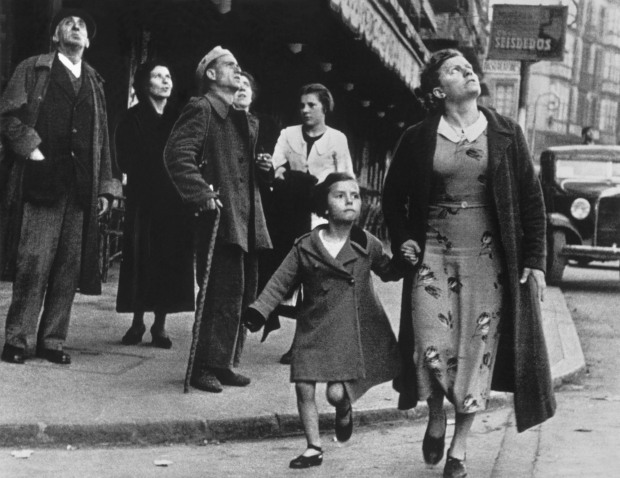 Running for shelter during the air raids. Bilbao, Spain, 1937. © Estate of Robert Capa and Magnum Photos.