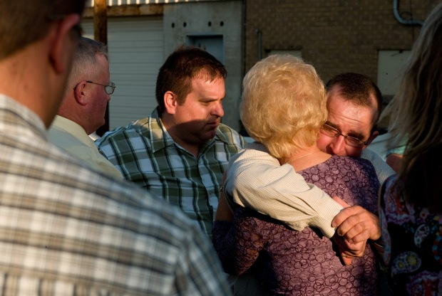 Miner Bodie Allred, right, cousin of missing miner Kerry Allred, embraces a friend at the memorial viewing in Price, Utah, for Dale Ray Black, one of the rescuers killed trying to free Kerry Allred and five others n the nearby Crandall Canyon mine. © Kevin Moloney, 2007
